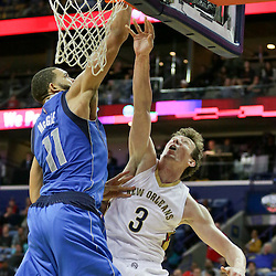 Jan 6, 2016; New Orleans, LA, USA; New Orleans Pelicans center Omer Asik (3) has a dunk blocked by Dallas Mavericks center JaVale McGee (11) during the second half of a game at the Smoothie King Center. The Mavericks defeated the Pelicans 100-91. Mandatory Credit: Derick E. Hingle-USA TODAY Sports