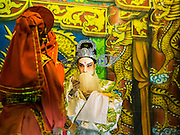 18 JANUARY 2015 - BANGKOK, THAILAND:  Performers with the Sai Yong Hong Opera Troupe on stage during a  performance at the Chaomae Thapthim Shrine, a Chinese shrine in a working class neighborhood of Bangkok near the Chulalongkorn University campus. The troupe's nine night performance at the shrine is an annual tradition and is the start of the Lunar New Year celebrations in the neighborhood. The performance is the shrine's way of thanking the Gods for making the year that is ending a successful one. Lunar New Year, also called Chinese New Year, is officially February 19 this year. Teochew opera is a form of Chinese opera that is popular in Thailand and Malaysia.             PHOTO BY JACK KURTZ