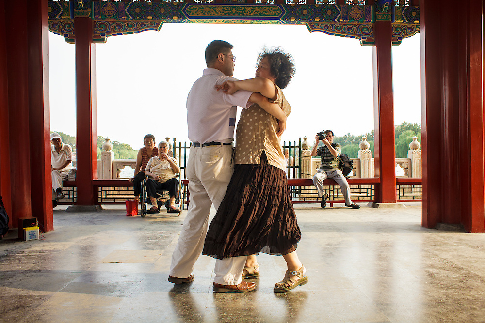 A couple dances in Behai Park in Beijing.