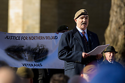© Licensed to London News Pictures. 26/04/2016. London, UK.  <br /> Robin Horsfall, former 22 SAS  talks to Northern Ireland Veterans on a parade before handing in a Petition 'Justice for Northern Ireland Veterans' to No 10 Downing St.  <br />  Photo credit: Anthony Upton/LNP