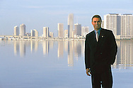 executive portrait,on location,standing with Miami skyline in background.