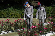 French soldiers look at the graves of fallen servicemen at the Remembrance Sunday ceremony at the Hodogaya, Commonwealth War Graves Cemetery in Hodogaya, Yokohama, Kanagawa, Japan. Sunday November 12th 2017. The Hodagaya Cemetery holds the remains of more than 1500 servicemen and women, from the Commonwealth but also from Holland and the United States, who died as prisoners of war or during the Allied occupation of Japan. Each year officials from the British and Commonwealth embassies, the British Legion and the British Chamber of Commerce honour the dead at a ceremony in this beautiful cemetery.