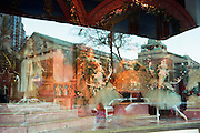 """Reflections in huge department store window in New Orleans at Christmastime. NOTE: Click """"Shopping Cart"""" icon for available sizes and prices. If a """"Purchase this image"""" screen opens, click arrow on it. Doing so does not constitute making a purchase. To purchase, additional steps are required."""