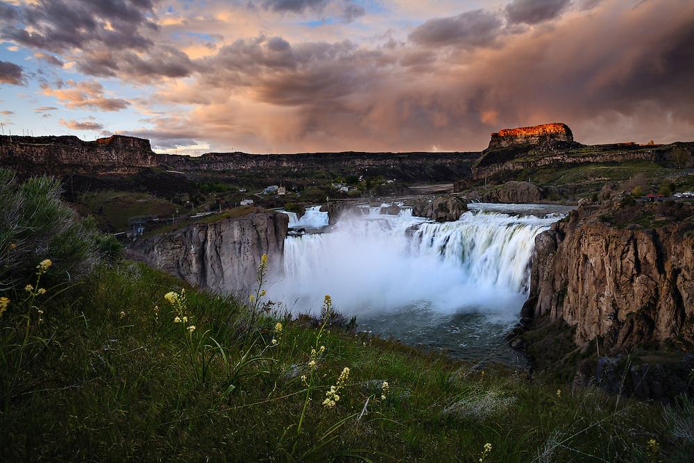 Summer storm on the horizon over Shoshone Falls in Twin Falls, Idaho.