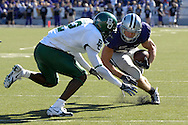 MANHATTAN, KS - OCTOBER 27:  Wide receiver Jordy Nelson #27 of the Kansas State Wildcats heads up field as defensive back Josh Bell #2 of the Baylor Bears moves in for the tackle in the first half, during a NCAA football game on October 27, 2007 at Bill Snyder Family Stadium in Manhattan, Kansas.  Kansas State won 51-13.  (Photo by Peter Aiken/Getty Images)