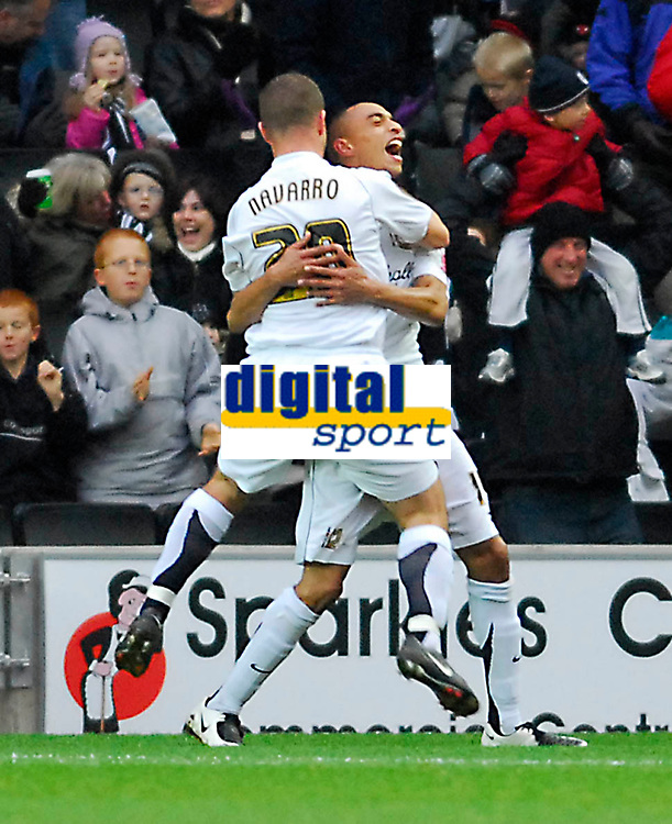 Photo: Leigh Quinnell/Sportsbeat Images.<br /> Milton Keynes Dons v Chesterfield. Coca Cola League 2. 24/11/2007. MK Dons Alan Navarro(20) congratulates Mark Wright on his goal.