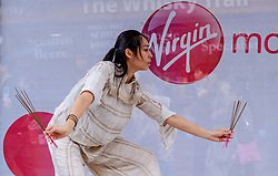Edinburgh Scotland 7th August 2016 :: Performers from Fringe shows entertain in the High Street to promote their shows.<br /> <br /> Pictured:  A young Japanese dancer performs in the High Street.<br /> <br /> (c) Andrew Wilson | Edinburgh Elite media