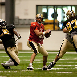 08 August 2009: Defensive end Anthony Hargrove (69) provides pressure on quarterback Mark Brunell (11) during the New Orleans Saints annual training camp Black and Gold scrimmage held at the team's indoor practice facility in Metairie, Louisiana.