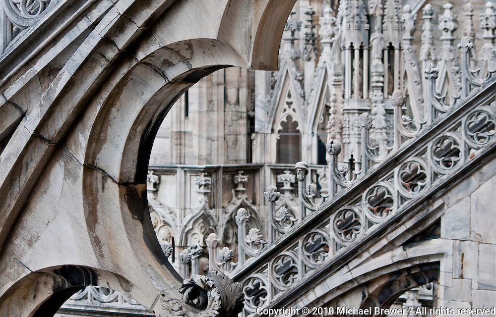 Milan, Italy, Duomo Cathedral. Details of the intricate, ornate, rooftop details of the cathedral.