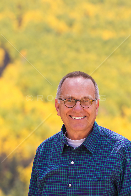portrait of a handsome mature man outdoors