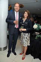 The HON.HARRY & MRS HERBERT at the launch of the 2009 Derby Festival in the presence of HRH Princess Haya of Jordan in aid of the charity Starlight held at the Kensington Roof Gardens, 99 Kensington High Street, London W8 on 12th May 2009.