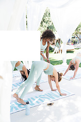 "Kourtney Kardashian opened up her palatial Calabasas home to host a swanky party for her newly-founded lifestyle blog, Poosh. The 40-year-old mother-of-three, who launched her blog earlier this year, was joined by her mother Kris Jenner along with a slew of celebs including Rosie Huntington-Whiteley, Suki Waterhouse, Adrienne Bailon, Rachel Roy, Malika and Khadijah Haqq, Nicole Williams, Simi and Haze Khadra, Melissa Alcantara and Yris Palmer. Guests received a hotel-like experience for the day as they were given a map of activities, picked out a swimsuit from Onia, slipped into a robe from Brooklinen, and popped by the Stuart Weitzman clubhouse for custom sneakers. Guests booked facials from Peach & Lily and massages from Squeeze, which were located on Kourtney's basketball court on Avocado Mattresses. Gymshark provided a shaded cabana oasis for a yoga class led by master trainer, Melissa Alcantara (@FitGurlMel). She took them through an energizing flow as they donned the Gymshark poise leggings and bralette tops in a mint shade that perfectly fit the event aesthetic. After yoga, attendees enjoyed a tea ceremony led by Shiva Rose to celebrate the full moon. Elle Macpherson's WelleCo offered naturopathic consultations from Dr. Simoné Laubscher along with a full elixir bar with smoothies and frozen yogurt made with their plant-based protein powder. To make sure guests were super chilled out, Hemple created CBD cocktails including ""Love Shots"" boosted with Hemple Sigma, crushed strawberries, cloudy apple juice, rosemary, and lime. Food was all organic and gluten-free catered by Bread and Wine. Guests enjoyed refreshing mini Tequila Don Julio Blanco margaritas and toasted the evening with custom Poosh engraved Don Julio 1942 bottles. The Poosh team toasted with Winc's Summer Water, Poosh Please Skinny Margaritas and Poosh-Perfect Paloma cocktails. For dessert, we cooled down with vegan treats from Dream Pops. Slip Silk staged a massive pillow pit, which was a hi"