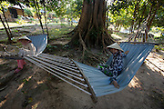 Phu Quoc Island. Ong Lang Beach. Mango Bay Resort. Girls with cone hats in hammocks.