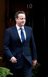 © London News Pictures. 18/12/2012. London, UK. British Prime Minister DAVID CAMERON outside 10 Downing street on December 18, 2012.   Photo credit: Ben Cawthra/LNP.