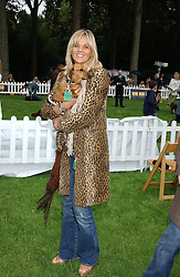LINDA BARKER and her dog Lilly at the 3rd annual Macmillan Dog Day in aid of Macmillan Cancer Relief held at Royal Hospital Chelsea, London SW3 on 5th July 2005.<br />