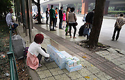 CHENGDU, CHINA - OCTOBER 9: (CHINA OUT) <br /> <br /> Father Dressed As Woman Sells Sanitary Napkins For Saving His Child <br /> <br /> Wang Hailin, a father dressed as woman sells sanitary napkins to collect money for his two and a half-year-old daughter with AIDS on October 9, 2014 in Chengdu, Sichuan province of China. Wang Hailin, a man dressed as woman sells sanitary napkins because his poor family can not afford his two and a half-year-old daughter\'s medical expense . A man selling feminine hygiene in street is weird so he has to dress as woman for higher sales.<br /> ©Exclusivepix