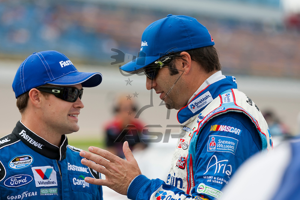 NEWTON, IA - AUG 04, 2012:  Ricky Stenhouse, Jr. (6) and Elliot Sadler (2) talk before qualifying for the U.S. Cellular 250 at the Iowa Speedway in Newton, IA.