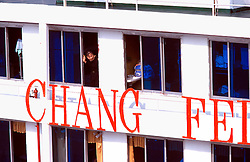 CHINA SICHUAN PROVINCE FENGDU MAY99 - A Chinese woman peers out from a window of a ferry moored at Fengdu. . © Jiri Rezac 1999. . Contact: +44 (0) 7050 110 417. Mobile:  +44 (0) 7801 337 683. Office:  +44 (0) 20 8968 9635. . Email:   jiri@jirirezac.com. Web:     www.jirirezac.com