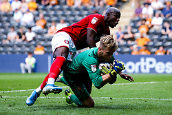 Benik Afobe of Bristol City clashes with George Long of Hull City - Mandatory by-line: Robbie Stephenson/JMP - 24/08/2019 - FOOTBALL - KCOM Stadium - Hull, England - Hull City v Bristol City - Sky Bet Championship