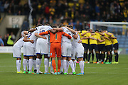 Group huddle during the Sky Bet League 2 match between Oxford United and AFC Wimbledon at the Kassam Stadium, Oxford, England on 10 October 2015.