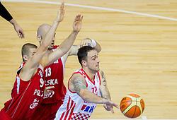 Przemyslaw Zamojski #9 of Poland and Marcin Gortat #13 of Poland vs Damir Markota #12 of Croatia during basketball match between National teams of Croatia and Poland in Round 1 at Day 4 of Eurobasket 2013 on September 7, 2013 in Arena Zlatorog, Celje, Slovenia. (Photo by Vid Ponikvar / Sportida.com)