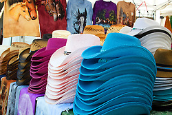 01 August 2014:   McLean County Fair.  A vendor displays cowboy style hats for sale