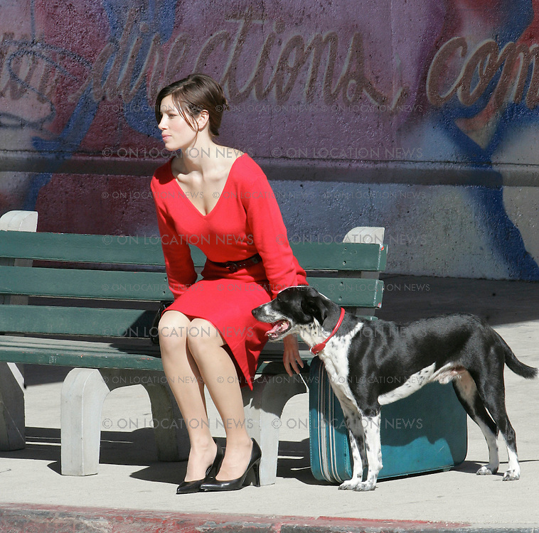 September 10, 2007 Los Angeles, CA. EXCLUSIVE Photo. Jessica Biel films scenes for Powder Blue. After doing a kissing scene with co star Edward Redmayne Biel films a scene where she is waiting for a bus with a dog. On set this day Jessica Biel was looking like the glamorous movie star that she is with some help from a team of make up, hair and lighting people. Photo by Eric Ford/ David Buchan/ On Location News. Sales; Eric Ford 818-613-3955 info@onlocationnews.com