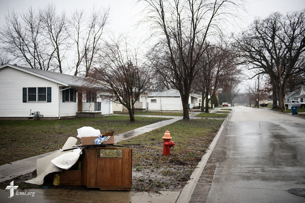 Flood-damaged furniture and building materials lay on the street outside homes on Saturday, Jan. 9, 2016, in Watseka, Ill. A flood at the end of December ravaged over a 60-block radius of the town. LCMS Communications/Erik M. Lunsford
