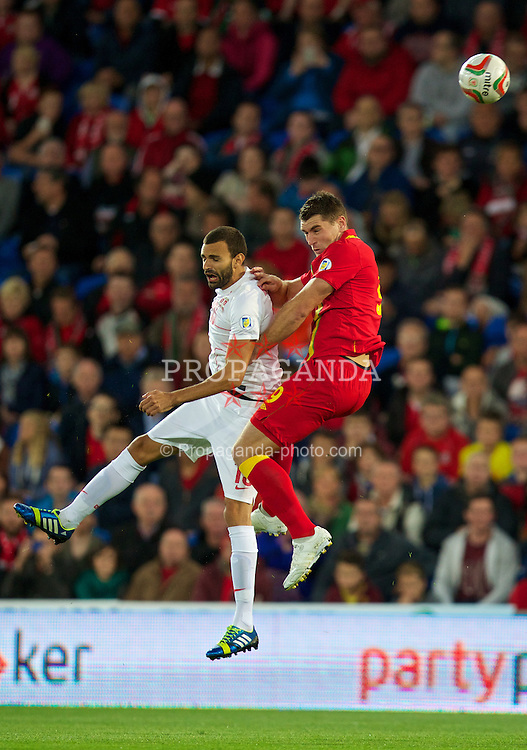 CARDIFF, WALES - Tuesday, September 10, 2013: Wales' Sam Vokes in action against Serbia's Ivan Radovanovic during the 2014 FIFA World Cup Brazil Qualifying Group A match at the Cardiff CIty Stadium. (Pic by David Rawcliffe/Propaganda)