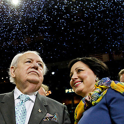 April 15, 2012; New Orleans, LA, USA; New Orleans Hornets newly named owner Tom Benson along with his wife Gayle celebrate as confetti falls behind them following a 88-75 win over the Memphis Grizzlies at the New Orleans Arena.   Mandatory Credit: Derick E. Hingle-US PRESSWIRE