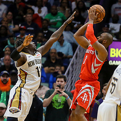 Mar 17, 2018; New Orleans, LA, USA; Houston Rockets guard Chris Paul (3) shoots over New Orleans Pelicans guard Jrue Holiday (11) during the fourth quarter at the Smoothie King Center. The Rockets defeated the Pelicans 107-101. Mandatory Credit: Derick E. Hingle-USA TODAY Sports