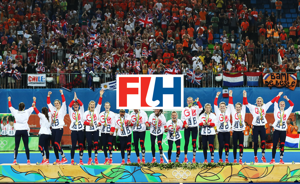 RIO DE JANEIRO, BRAZIL - AUGUST 19:  Great Britain celebrate on the podium after winning a penalty shoot out during the Women's Hockey final between Great Britain and the Netherlands on day 14 at Olympic Hockey Centre on August 19, 2016 in Rio de Janeiro, Brazil. (Photo by Ian MacNicol/Getty Images)