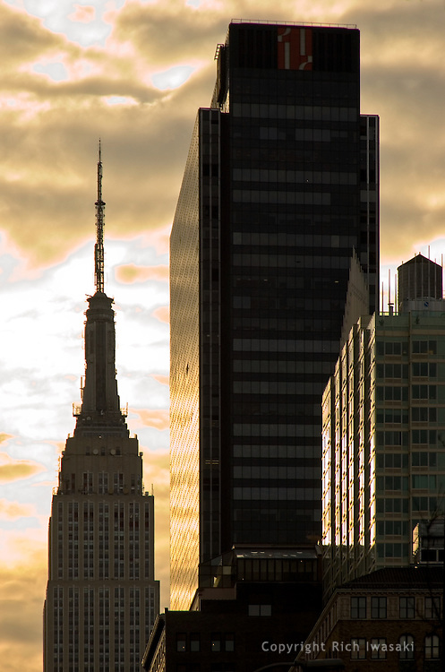 Silhouette of Empire State Building and office buildings at sunrise, mid-town Manhattan, New York City,  New York