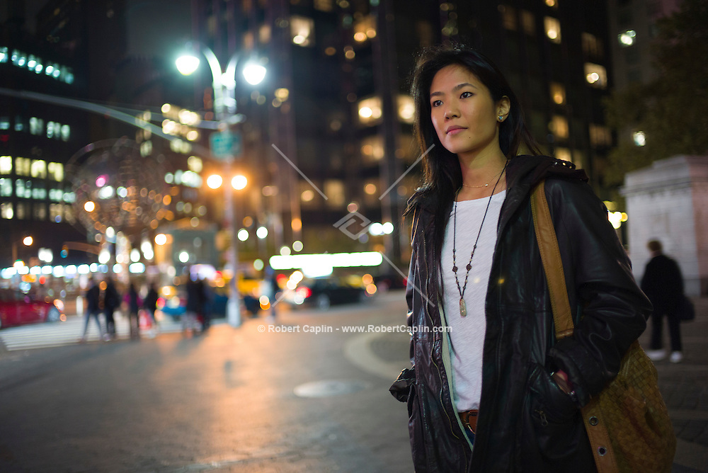 Photographer Nicole Tung in New York at Columbus Circle in Manhattan. <br /> <br /> Photo &copy; Robert Caplin