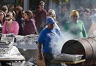 Warwick, New York  - Two women barbecue food in a grill made from a 55-gallon drum during the Applefest harvest celebration on Oct. 3, 2010.