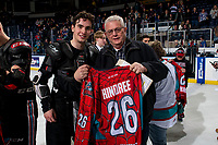 KELOWNA, CANADA - MARCH 16:  Liam Kindree #26 of the Kelowna Rockets poses for a photo with the winning fan on March 16, 2019 at Prospera Place in Kelowna, British Columbia, Canada.  (Photo by Marissa Baecker/Shoot the Breeze)
