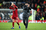 Captain Liverpool midfielder Jordan Henderson (14) and Liverpool Manager Jurgen Klopp applaud the Kop at the end of the Champions League Group C match between Liverpool and Napoli at Anfield, Liverpool, England on 11 December 2018.