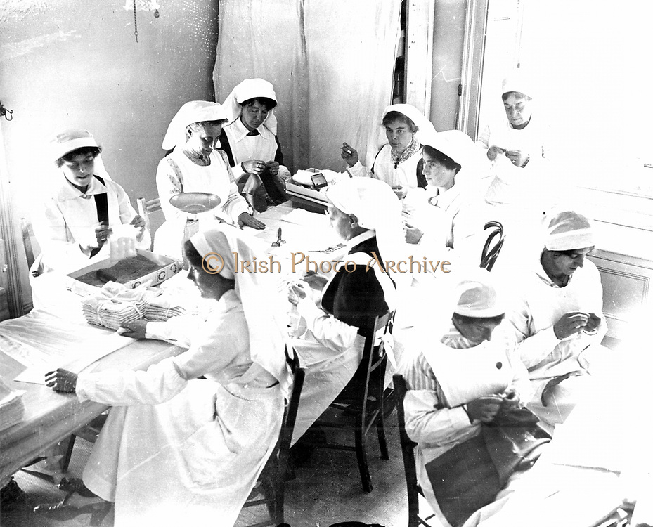 World War I - 1914-1919: Streatham Common War Supply Depot, South London, organised by Lady Herbert Parsons.  Some of the 700 to 800 volunteers preparing surgical dressings for Red Cross hospitals. Photograph.