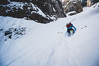 Caroline Gleich boots up the Benson and Hedges Couloir in the Wasatch Mountains.