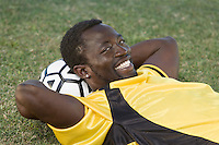 Soccer Player Using Ball as Pillow