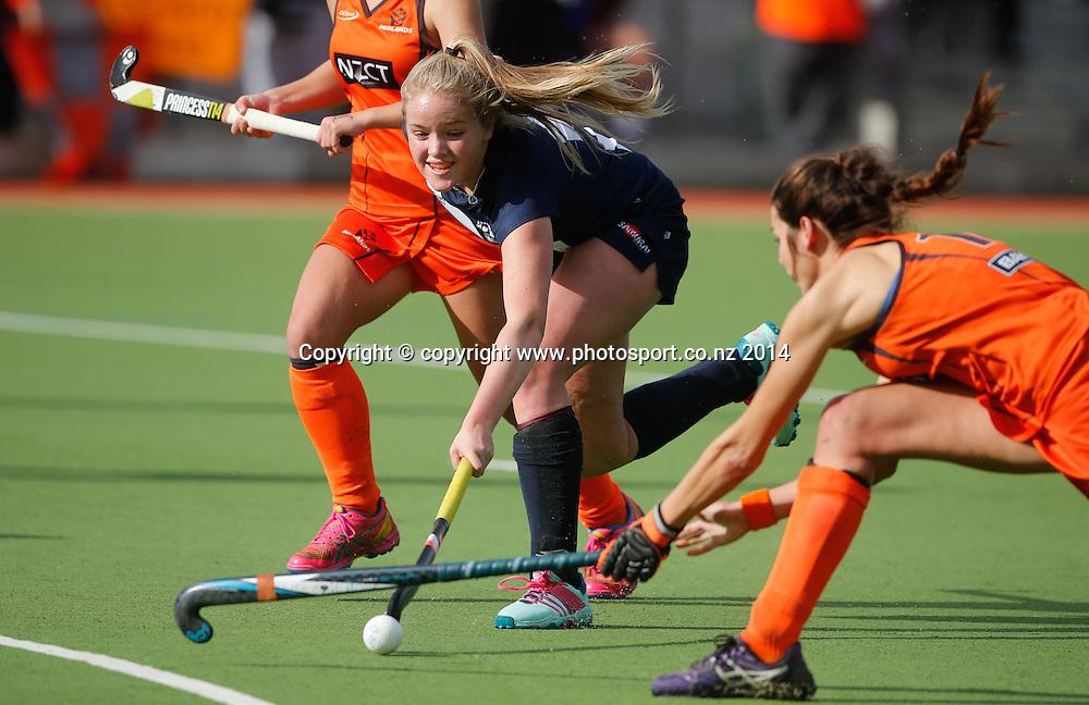 Auckland's Maddison Evans beats the defence. Auckland v Midlands, Final - Womens National U18 Regional Hockey Tournament, Napier, New Zealand. Saturday, 12 July, 2014. Photo: John Cowpland / photosport.co.nz