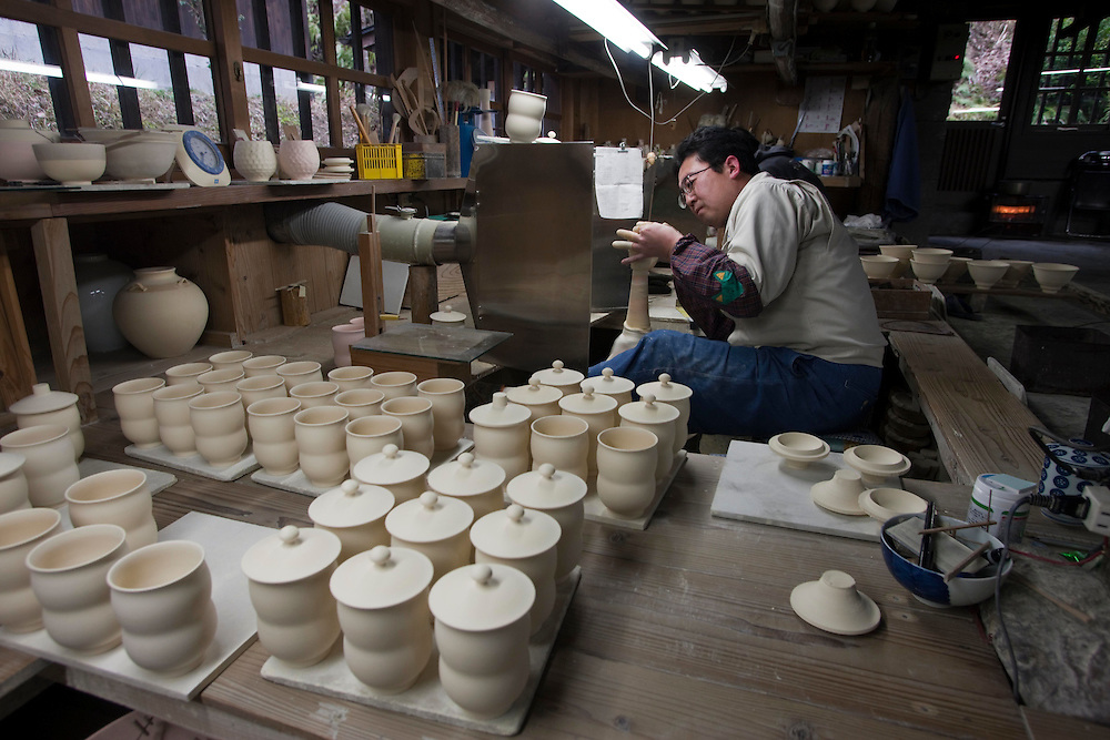 The 250-year-old Gen-emon kiln (2726 Maruo-hei, Arita-cho; +81-955-42-4164; www.gen-emon.co.jp) preserves the tradition of Shoki Imari pottery whilst adding a contemporary touch to its porcelain line. Executive Director, Shoji Kaneko invites visitors to mix and match when choosing their tableware--finding beauty in the mismatch of style. Dissimilar to Kakiemon's fine decorative lines the hand painted Gen-emon uses energetic bush strokes to colour each piece.