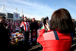 A general view of Stoke City fans as they pose for photographs in front of the Gordon Banks statue outside of the bet365 Stadium