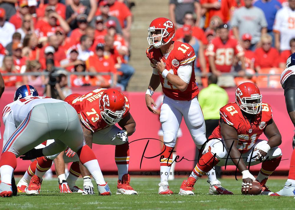 KANSAS CITY, MO - SEPTEMBER 29:  Quarterback Alex Smith #11 of the Kansas City Chiefs calls out a play at the line against the New York Giants during the first half on September 29, 2013 at Arrowhead Stadium in Kansas City, Missouri.  (Photo by Peter G. Aiken/Getty Images) *** Local Caption ***  Alex Smith