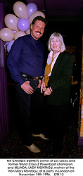 MR CHARLES BURNETT, owner of Los Locos and former World Class 2 Powerboat champion, and BELINDA, LADY MONTAGU, mother of the Hon.Mary Montagu, at a party in London on November 19th 1996.    LTO 13