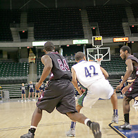 Falcon forward Alex Clark (24) looking for way to steal from Wolves forward Kyndall Smith-Tomlin (42)
