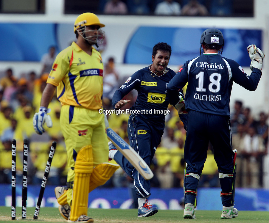 Deccan Chargers Bowler Pragiyan Ojha Celebrates With Adam Gilchrist Chennai Super Kings Batsman MS Dhoni Wicket During The Indian Premier League - 42nd match Twenty20 match  2009/10 season Played at Vidarbha Cricket Association Stadium, Jamtha, Nagpur 10 April 2010 - day/night (20-over match)