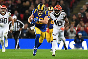 CAPTION CORRECTION LA LA Rams Wide Receiver Cooper Kupp (18) runs the ball chased by Cincinnati Bengals Defensive Back Brandon Wilson (40) during the International Series match between Los Angeles Rams and Cincinnati Bengals at Wembley Stadium, London, England on 27 October 2019.