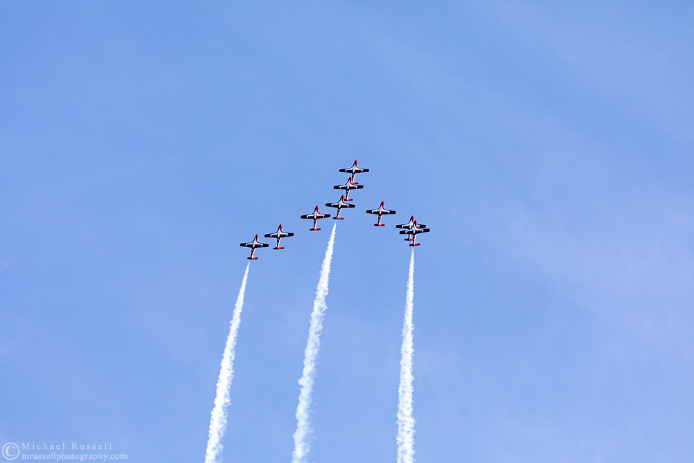 Canadian Forces Snowbirds starting a loop in the Canada Goose formation with smoke.  The Snowbirds are also known as the 431 Air Demonstration Squadron and fly the Canadair CT-114 Tutor jet. Photographed during the Canada 150 celebrations in White Rock, British Columbia, Canada.