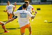 Bradford City midfielder Romain Vincelot (6) warming up with a unite bowel cancer message on his t shirt during the EFL Sky Bet League 1 match between Bury and Bradford City at the JD Stadium, Bury, England on 8 April 2017. Photo by Simon Davies.
